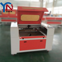 Over size of machine is 1300*900mm table laser cutter cutting fabric leather