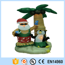 Funny christmas inflatable light up Santa Claus with coconut tree and penguin for sale