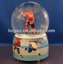 ice hockey player snow globe