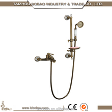 Old Fashioned Gold Plated Single Handle Wall Mounted Waterfall Antique Brass Bathtub Faucet With Ceramic Decoration Soap Holder