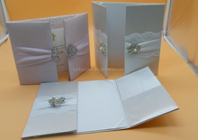 silk wedding invitation folios with ribbons and brooch