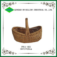 Boat shaped wicker fishing basket