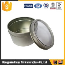 small round tin with clear window lid