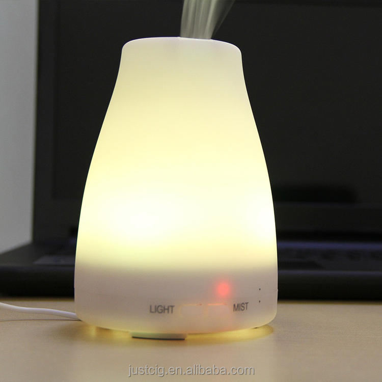 Essential oil diffuser 120ml aromatherapy diffuser portable ultrasonic aroma humidifier with 7 color changing LED lamps