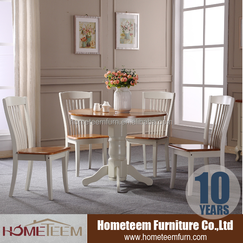 round cream colored dining room table and chairs