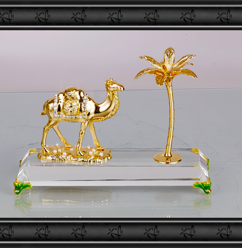 Souvenir crystal with gold plated metal camel and coconut tree