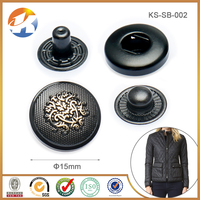 Black painting snap buttons with embossed logo