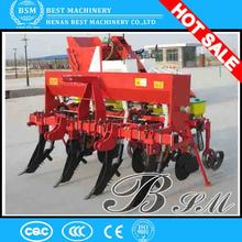 Tractor driving corn planter 4 row maize seeder