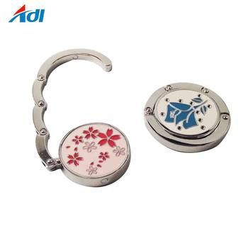 China made custom flower logo metal bag hanger holder