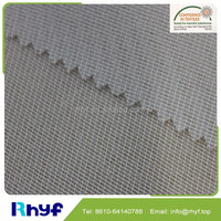 Low price100 polyester knit weft inserted interlining fabric