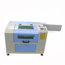 Mini size co2 laser engraving laser cutting machine for leather jacket cutting at a low price