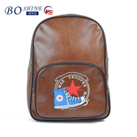 Wholesale latest fashion children brown school bag backpack with printing and front pocket for high class student