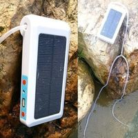 Portable solar aquarium air pump with USB mobile phone charger