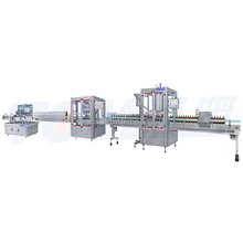 Wine bottle filling, capping and labeling machine