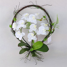 Artificial white orchids arrangements growing on root ring