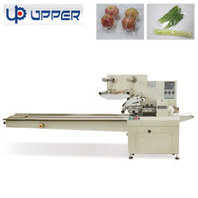 Horizontal flow fruit and vegetable automatic packing machine