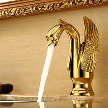 Swan shape gold finishing bathroom faucet