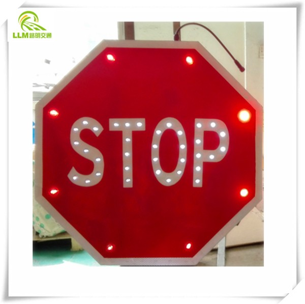 School bus crossing guard stop signs