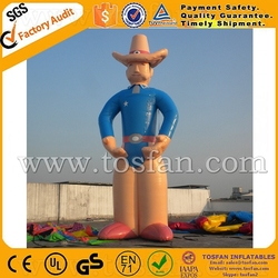 Giant inflatable cow boy character ground balloon for advertising F1053