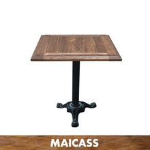 Wrought iron reclaimed wood square dining table restaurant