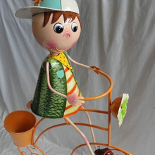 metal boy with bike garden decoration flower planter