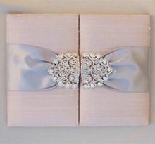 Classy & luxurious pink silk folio wedding invitation with pearl brooch & gray ribbons