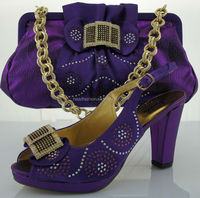 african wedding sandal shoes and matching bag in purple color
