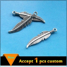 Fashion jewelry wholesale alloy antique silver curved feather pendant charms