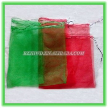 green mono HDPE date palm mesh net bag with black drawstrings