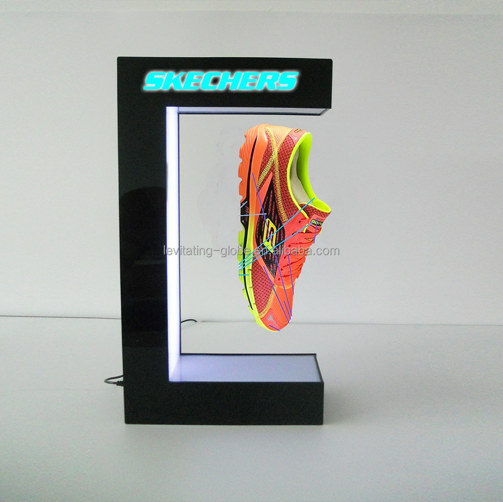Magnetic advertising floating shoe display stand