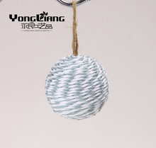 handmade grey and white paper yarn making up the ball
