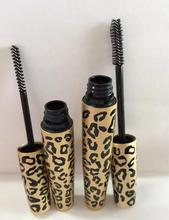 Animal looking small black logo mascara container