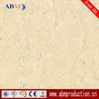 60x60and 80x80 cm ivory colored vitrified floor tiles which is travertine series