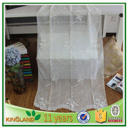 Window curtain covering striped sheer curtain