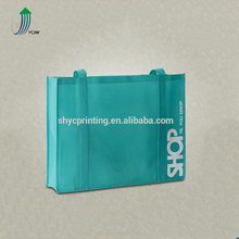 Cheap big size custom promotional length handle pp non-woven shopping bag