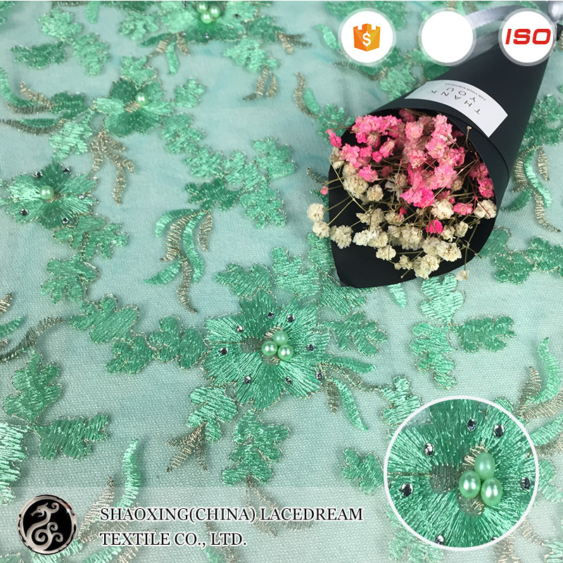 China Wholesale embroidery beaded latest green lace fabric designs punjabi suits