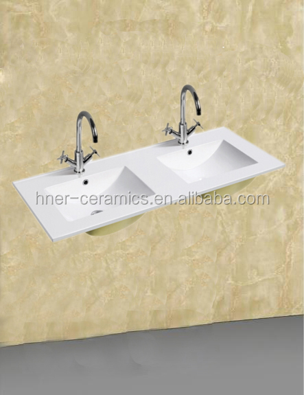 Double Wash Hand Basin mounted above cabinet