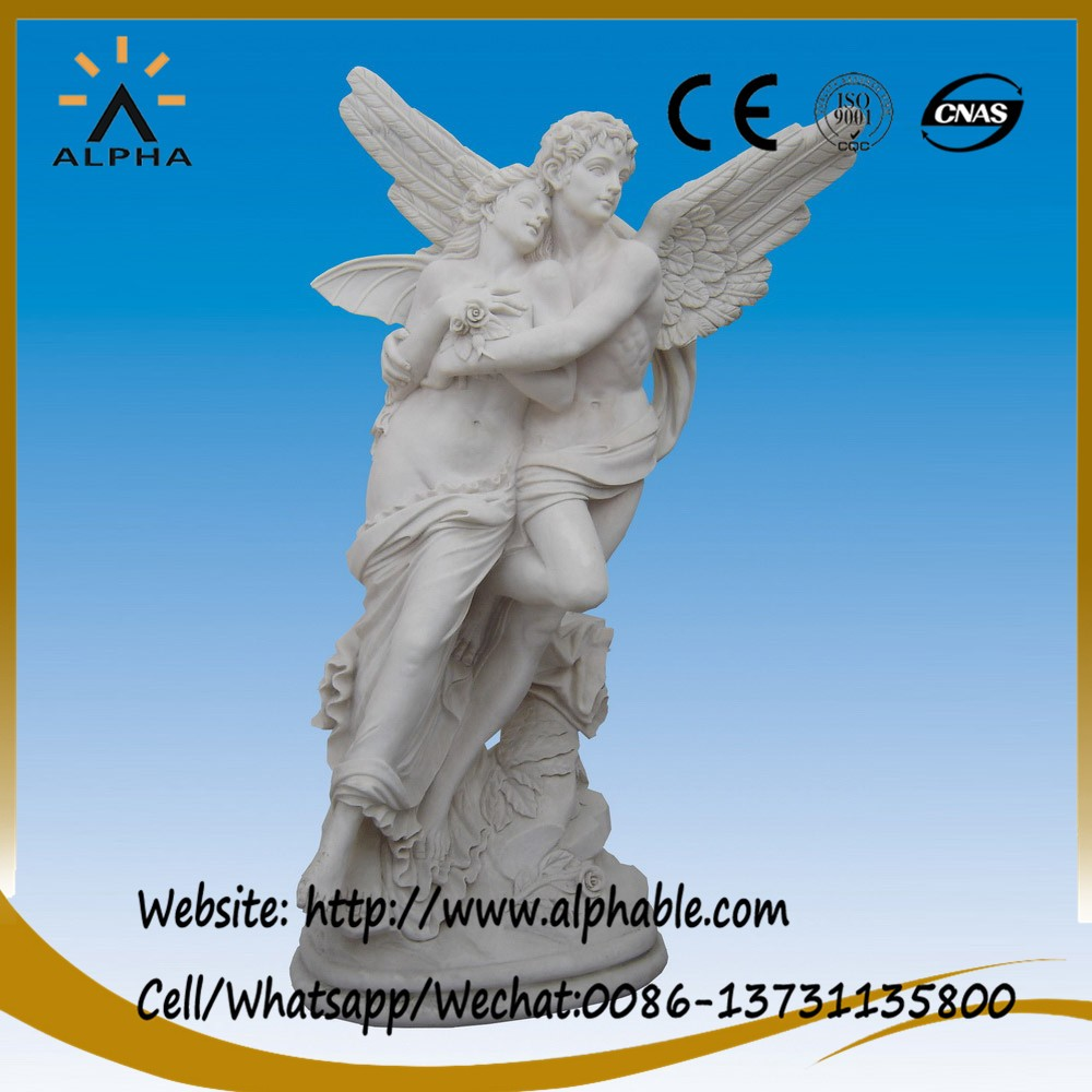 Carved marble girl and boy angels statues