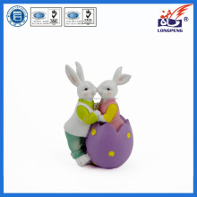 Polyresin rabbit couple is kissing on an egg,easter rabbit figurine