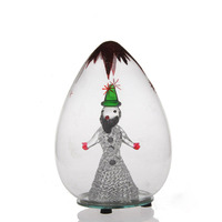 green delicate figurine in christmas glass ball with round mirror led light base