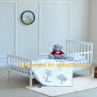 Wooden toddler cot