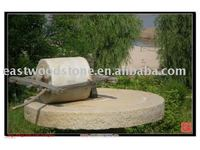 old millstone/antiqued stone trough