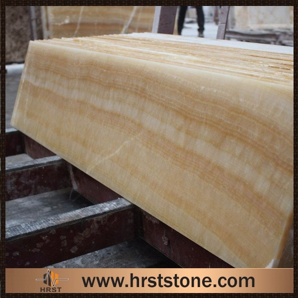 Lighted yellow honey onyx bar tops