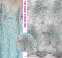 well-know China supplier handwork embroidery designs tulle fabric /beaded lace fabric net embroidered for paty dress
