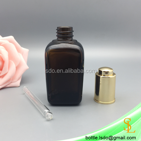 Empty square shape amber glass 50ml essential oil bottle for essential oil/attar/serum, gold pump press cap