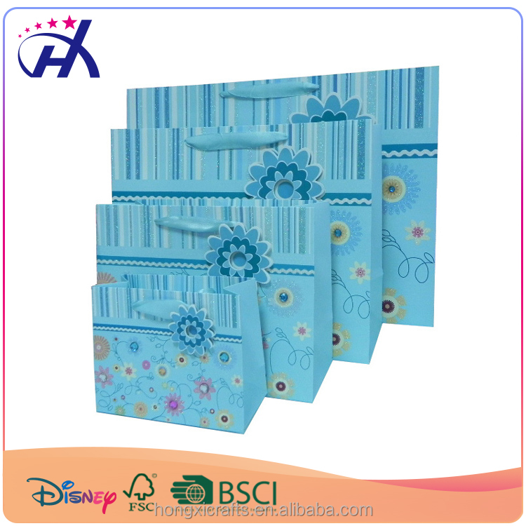 Recyclable OEM based bright blue color ribbon paper tie gift bags with protruding flower