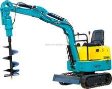 crawler excavator with trench digger and snow blade