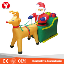 Inflatable santa with camper, santa with sleigh and reindeer