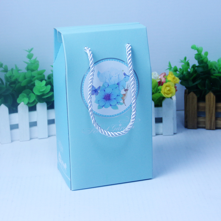 Light blue cardboard paper box with handle gable gift boxes gift box packaging