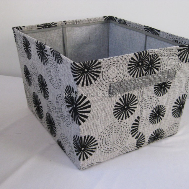 Canvas storage basket with iron frame.